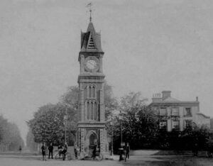 Cheveley House (to the right of the clock tower) in about 1912, when it would have been the surgery of Dr Ernest Fyson - Bury Road is on the left of the picture (see below or click image for source and acknowledgements etc., ref. Image 1).