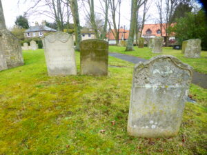 The Fyson section of Exning churchyard, the white grave in the background on the left being that of Mary Fyson, likely Robert Fyson's grandmother, Ernest Last Fyson's great grandmother (see below or click image for source and acknowledgements etc., ref. Image 1).
