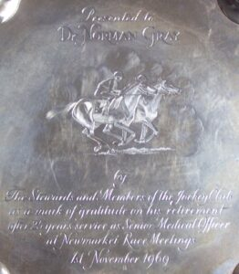 Central section of a salver presented to Norman Gray by the Jockey Club in 1969, when he stepped down as their Senior Medical Officer at Newmarket race meetings after 25 years of service (see below or click image for source and acknowledgements etc., ref. Image 2).