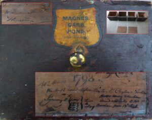The front of the drawer referred to above, inset with a photograph showing the surviving drawers and slabs (top right), a slab mentioning 'Woodward Mudd Hunston' (top left), and the lower half inset with the back of the 'MAGNES. CARB. POND.' drawer shown, mentioning 'W Mudd' then underneath 'W Mudd bound apprentice to Mr. Clayton Norton January 8th {1801 1802 1803 1804 1805} time to stay' (see below or click image for source and acknowledgements etc., ref. Image 2).